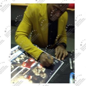 Frank Bruno Signed Boxing Photograph: Fighting Mike Tyson. Damaged