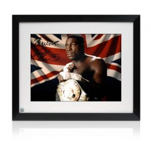 Frank Bruno Signed Boxing Photo: The WBC World Heavyweight Champion. Framed