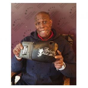 Frank Bruno Signed Black Boxing Glove With Black Cuff. In Display Case