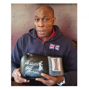 Frank Bruno Signed Black Boxing Glove. Damaged Stock C