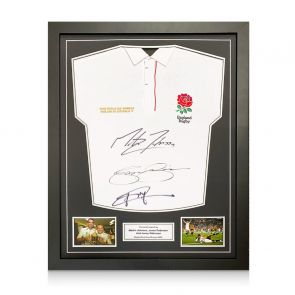 Jonny Wilkinson, Martin Johnson And Jason Robinson Signed England Rugby Shirt. Standard Frame