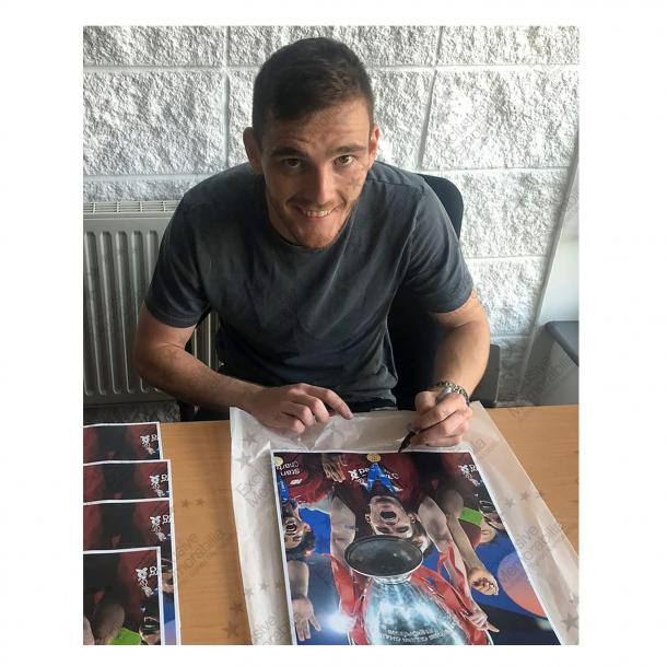 Win an Andy Robertson signed photo!