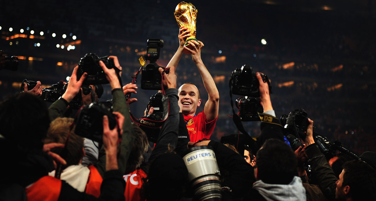 Andres Iniesta holding the world cup trophy
